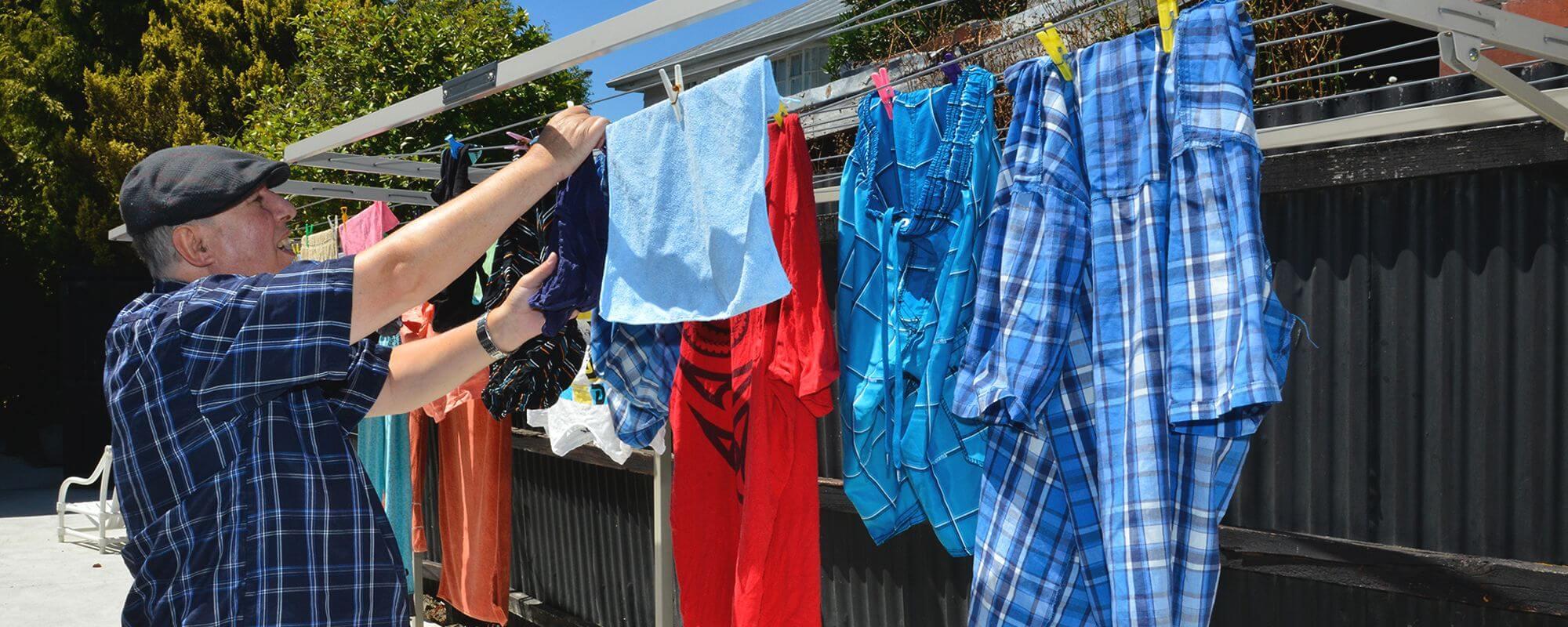 Hohepa Canterbury Resident hanging washing